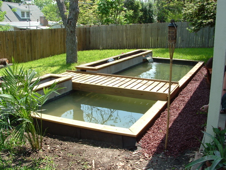 Wooden fish pond house of fishery lovers for Wooden koi pool